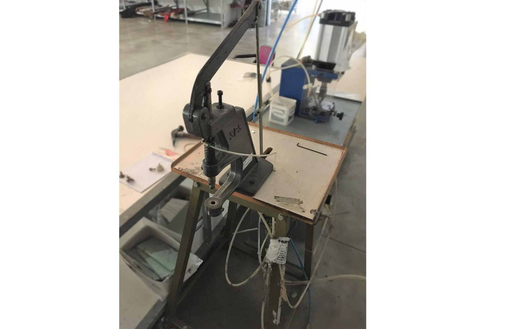 PERFORATING AND EYELETTING MACHINE